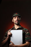 Soldier. Portrait of soldier holding white board stock image