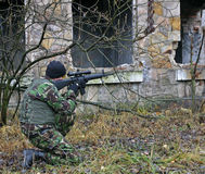 Soldier in action. Asg game in old deserted factory Stock Images