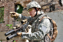 Soldier in action. US Army soldier in combat action Stock Photos