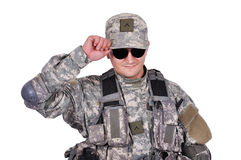 Soldier adjusts his cap Royalty Free Stock Photo