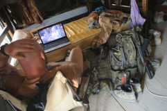 Soldier in Afghanistan. Member of the Army of the Czech Republic watching a movie during his free time on the combat outpost in Pol-e Alam, Logar Province Stock Images