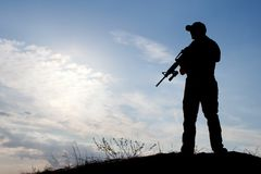 Soldier against the sun Royalty Free Stock Image