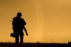 Soldier against a sunset Royalty Free Stock Images