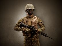 Soldier agent in a dark space with arms stock photography