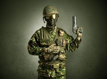 Soldier agent in a dark space with arms royalty free stock photo