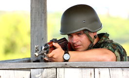 A soldier aiming stock photography