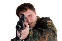 Soldier aiming a gun Stock Photos