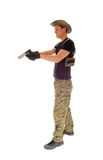 Soldier aiming his handgun. Royalty Free Stock Images