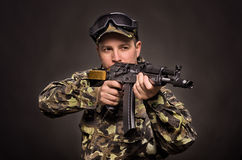 Soldier aiming a machine gun. On a black background Royalty Free Stock Photo