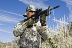 Soldier Aiming With Machine Gun Royalty Free Stock Photo
