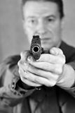 Soldier aiming a pistol Colt Royalty Free Stock Photography