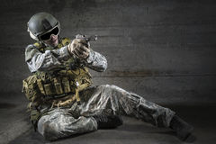 Soldier aiming a pistol Stock Photos