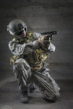 Soldier aiming a pistol Royalty Free Stock Photos