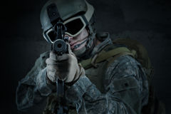 Soldier aiming a rifle at you Royalty Free Stock Photography