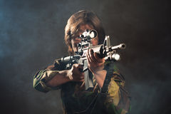 Soldier aiming a weapon. Mercenary soldier holding a weapon Royalty Free Stock Photo