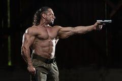 Soldier Aims A Gun Stock Photo