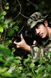Soldier aims at his target Stock Photo