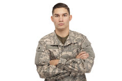 Soldier with arms crossed against white Royalty Free Stock Photo
