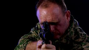 Soldier holding assault rifle. Soldier in army fatigues holding assault rifle stock footage