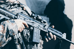Soldier with assault rifle, officer give orders. Soldier with assault rifle royalty free stock photography