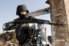 Soldier with automatic AK-47 rifle Royalty Free Stock Image