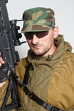 The soldier with an automatic assault rifle Stock Image
