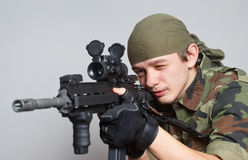 Soldier with an automatic assault rifle Stock Photos