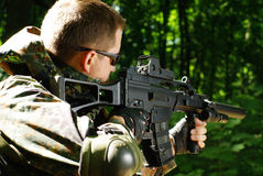 The soldier with automatic rifle Stock Photo