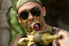 Soldier in bandana targeting with a gun. Commando on hunt, watch out Royalty Free Stock Photo