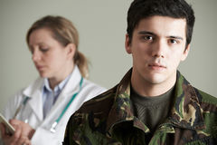Soldier Being Assessed By Doctor royalty free stock photography