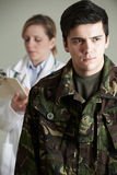 Soldier Being Assessed By Doctor Stock Photography