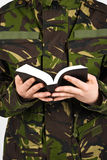 Soldier with bible Stock Photography