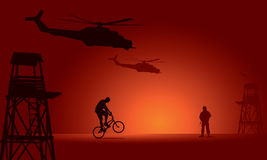 Soldier and biker with watchtower Stock Image