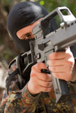 Soldier in black mask with a gun Stock Image