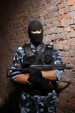 Soldier in black mask holding a gun Stock Photography