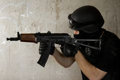 Soldier in black mask targeting with AK-47 rifle Royalty Free Stock Image