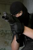 Soldier in black mask targeting with AK-47 rifle Stock Images