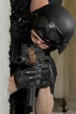 Soldier in black mask targeting with AK47 rifle Stock Images