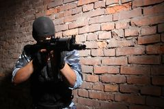 Soldier in black mask targeting with a gun Stock Photography