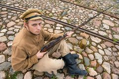 Soldier with boiler and gun in retro style picture Royalty Free Stock Photos