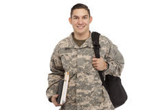 Soldier with books and bag Royalty Free Stock Images