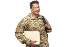 Soldier with books and bag Royalty Free Stock Photo