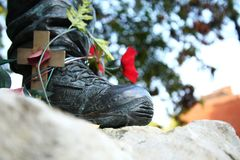 The soldier boot and poppy flower scene. The soldier boot and poppy flower represent the remembrance and flower abstract concept related idea Stock Photography