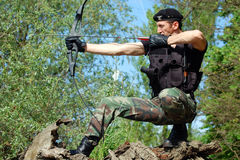Soldier with bow and arrow Stock Photography