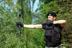 Soldier with bow and arrow Stock Images