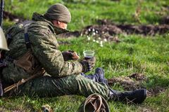 Soldier breakfast on the battlefield royalty free stock images
