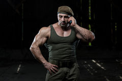 Soldier Calls Home On Cell Phone Royalty Free Stock Images