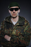 Soldier in camouflage and ammunition Royalty Free Stock Image