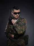 Soldier in camouflage and ammunition with knife Stock Photo