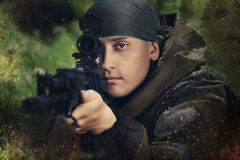 Soldier. In camouflage with a Kalashnikov assault rifle Royalty Free Stock Images